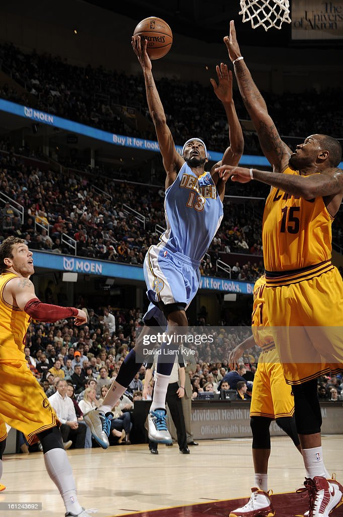 <a gi-track='captionPersonalityLinkClicked' href=/galleries/search?phrase=Corey+Brewer&family=editorial&specificpeople=234749 ng-click='$event.stopPropagation()'>Corey Brewer</a> #13 of the Denver Nuggets goes up for the shot against <a gi-track='captionPersonalityLinkClicked' href=/galleries/search?phrase=Marreese+Speights&family=editorial&specificpeople=4187263 ng-click='$event.stopPropagation()'>Marreese Speights</a> #15 of the Cleveland Cavaliers at The Quicken Loans Arena on February 9, 2013 in Cleveland, Ohio.