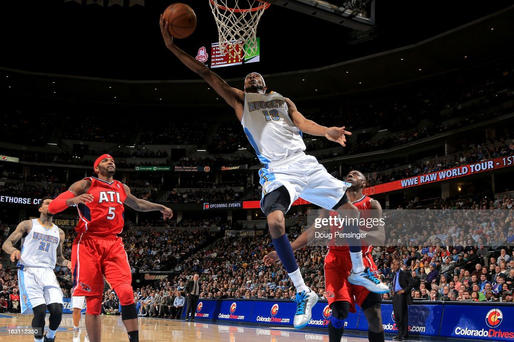 <a gi-track='captionPersonalityLinkClicked' href=/galleries/search?phrase=Corey+Brewer&family=editorial&specificpeople=234749 ng-click='$event.stopPropagation()'>Corey Brewer</a> #13 of the Denver Nuggets lays in a shot against <a gi-track='captionPersonalityLinkClicked' href=/galleries/search?phrase=Josh+Smith+-+Basketball+Player+-+Born+1985&family=editorial&specificpeople=201983 ng-click='$event.stopPropagation()'>Josh Smith</a> #5 of the Atlanta Hawks and <a gi-track='captionPersonalityLinkClicked' href=/galleries/search?phrase=Anthony+Tolliver&family=editorial&specificpeople=4195496 ng-click='$event.stopPropagation()'>Anthony Tolliver</a> #4 of the Atlanta Hawks at the Pepsi Center on March 4, 2013 in Denver, Colorado. The Nuggets defeated the Hawks 104-88.