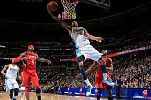 Corey Brewer of the Denver Nuggets lays in a shot against Josh Smith of the Atlanta Hawks and Anthony Tolliver of the Atlanta Hawks at the Pepsi...