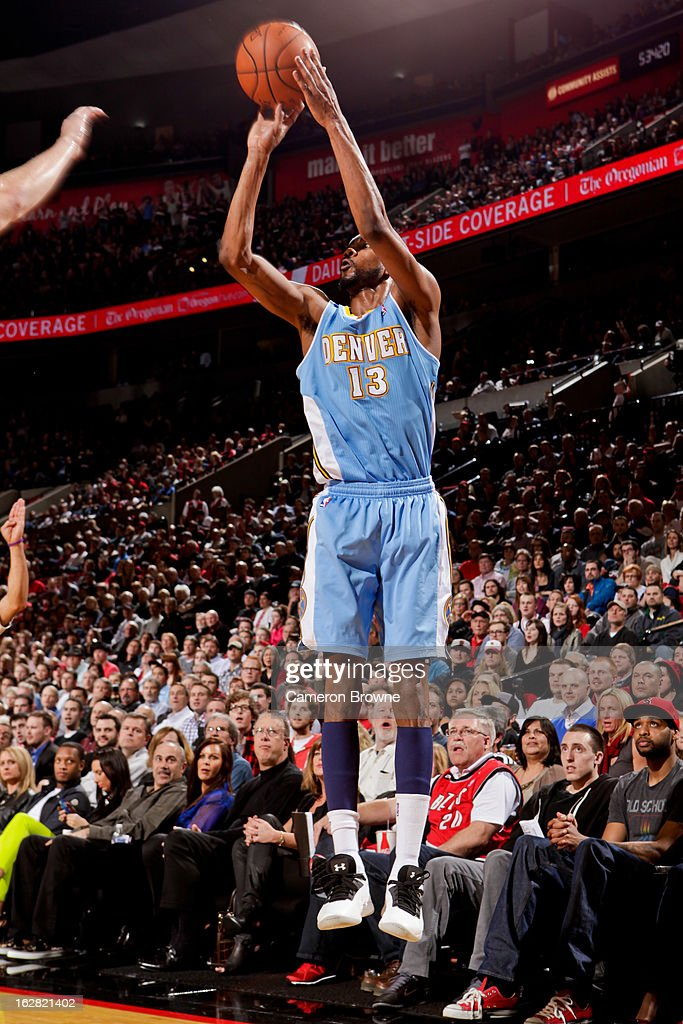 Corey Brewer #13 of the Denver Nuggets shoots a three-pointer against the Portland Trail Blazers on February 27, 2013 at the Rose Garden Arena in Portland, Oregon.