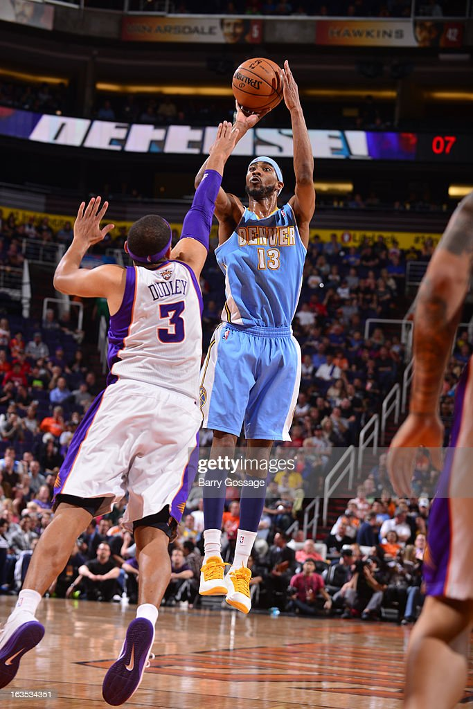 Corey Brewer #13 of the Denver Nuggets shoots against Jared Dudley #3 of the Phoenix Suns on March 11, 2013 at U.S. Airways Center in Phoenix, Arizona.