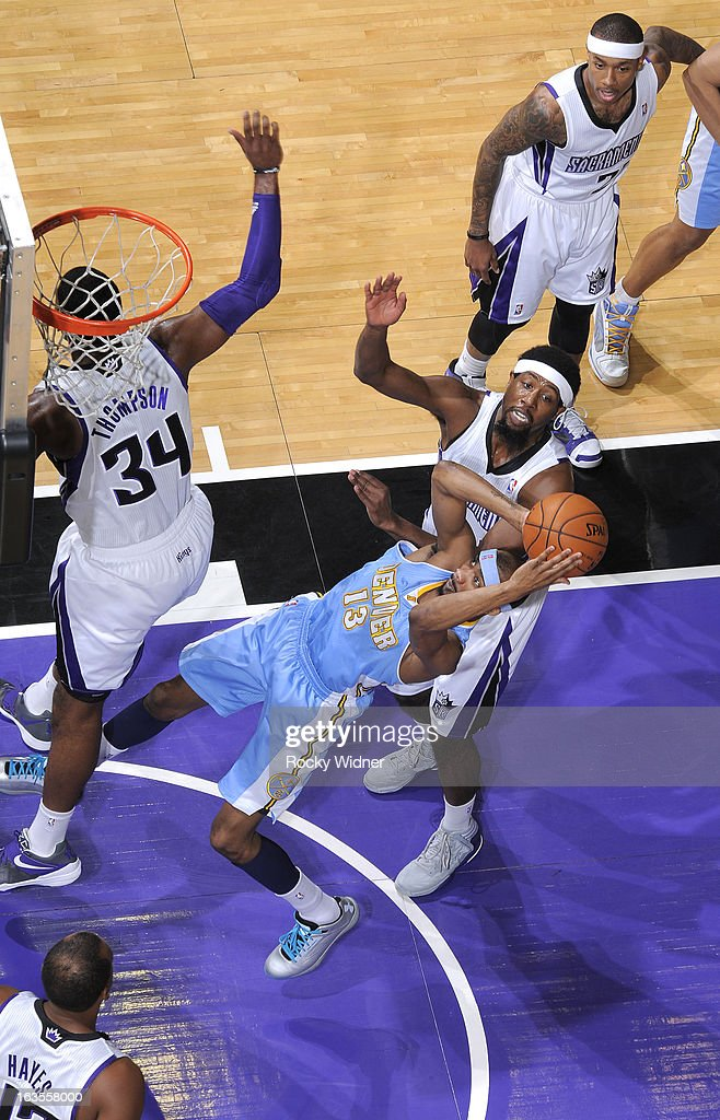 Corey Brewer #13 of the Denver Nuggets shoots against John Salmons #5 of the Sacramento Kings on March 5, 2013 at Sleep Train Arena in Sacramento, California.
