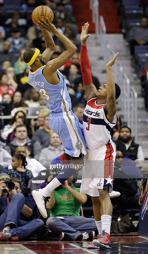 <a gi-track='captionPersonalityLinkClicked' href=/galleries/search?phrase=Corey+Brewer&family=editorial&specificpeople=234749 ng-click='$event.stopPropagation()'>Corey Brewer</a> #13 of the Denver Nuggets shoots over <a gi-track='captionPersonalityLinkClicked' href=/galleries/search?phrase=Bradley+Beal&family=editorial&specificpeople=7640439 ng-click='$event.stopPropagation()'>Bradley Beal</a> #3 of the Washington Wizards during the second half at Verizon Center on February 22, 2013 in Washington, DC.