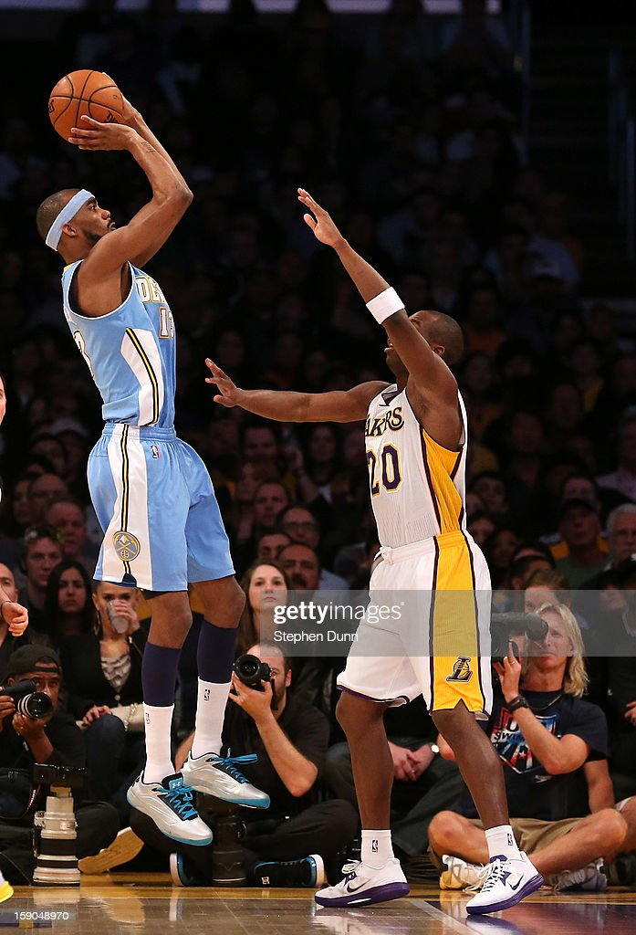 Corey Brewer #13 of the Denver Nuggets shoots over Jodie Meeks #20 of the Los Angeles Lakers at Staples Center on January 6, 2013 in Los Angeles, California.
