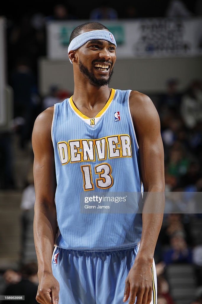 <a gi-track='captionPersonalityLinkClicked' href=/galleries/search?phrase=Corey+Brewer&family=editorial&specificpeople=234749 ng-click='$event.stopPropagation()'>Corey Brewer</a> #13 of the Denver Nuggets smiles during the game against the Dallas Mavericks on December 28, 2012 at the American Airlines Center in Dallas, Texas.