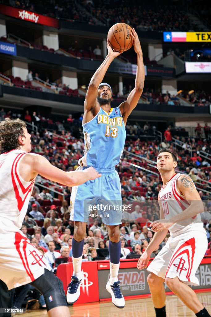 <a gi-track='captionPersonalityLinkClicked' href=/galleries/search?phrase=Corey+Brewer&family=editorial&specificpeople=234749 ng-click='$event.stopPropagation()'>Corey Brewer</a> #13 of the Denver Nuggets takes a shot against the Houston Rockets on January 23, 2013 at the Toyota Center in Houston, Texas.