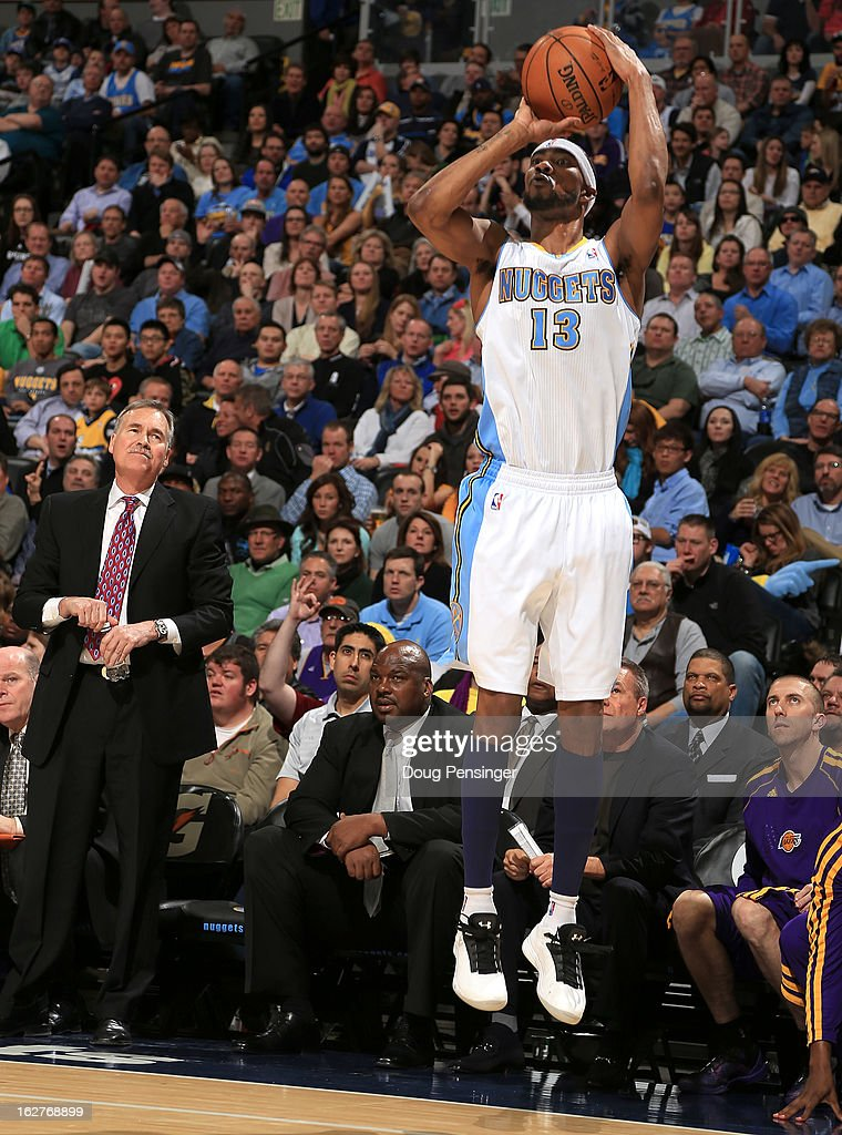 Corey Brewer #13 of the Denver Nuggets takes a shot as head coach Mike D'Antoni (L) of the Los Angeles Lakers watches at the Pepsi Center on February 25, 2013 in Denver, Colorado. The Nuggets defeated the Lakers 119-108.