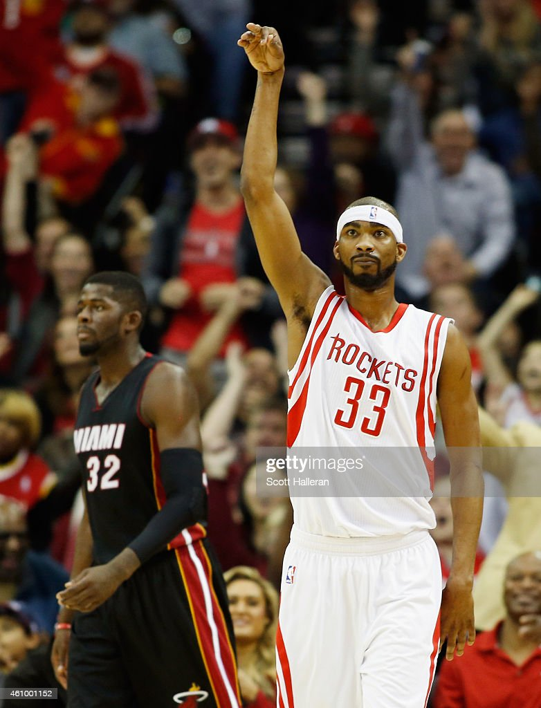 Corey Brewer of the Houston Rockets celebrates a threepoint basket as James Ennis of the Miami Heat looks on during their game at the Toyota Center...