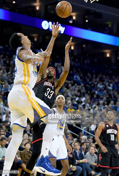 Corey Brewer of the Houston Rockets shoots over Shaun Livingston of the Golden State Warriors during an NBA basketball game at ORACLE Arena on...
