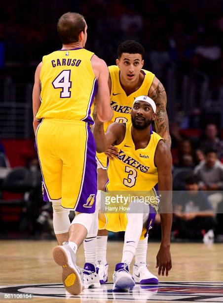 Corey Brewer of the Los Angeles Lakers gets help getting up from Alex Caruso and Kyle Kuzma during a 111104 win over the LA Clippers at Staples...
