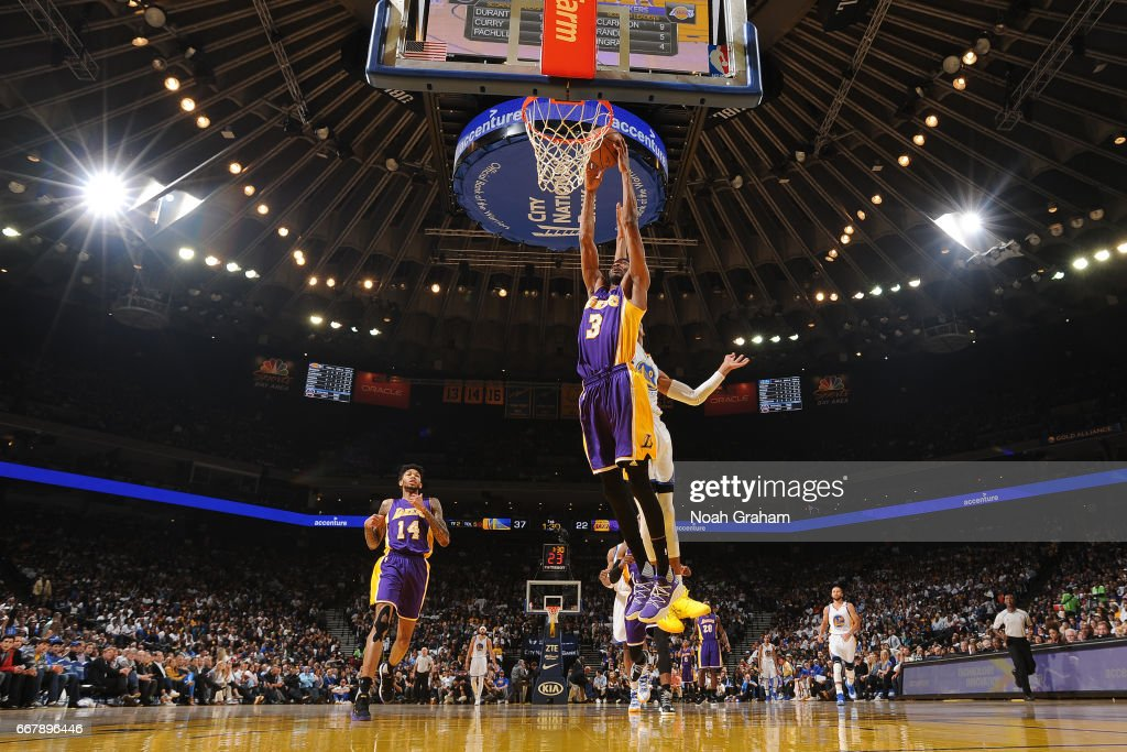 Corey Brewer #3 of the Los Angeles Lakers goes up for a dunk against the Golden State Warriors on April 12, 2017 at ORACLE Arena in Oakland, California.
