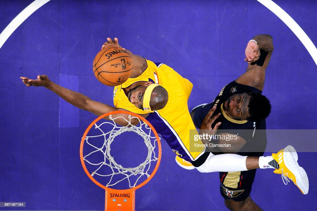 Corey Brewer #3 of the Los Angeles Lakers scores a basket against Solomon Hill #44 of the New Orleans Pelicans during the first half of the basketball game at Staples Center April 11, 2017, in Los Angeles, California.