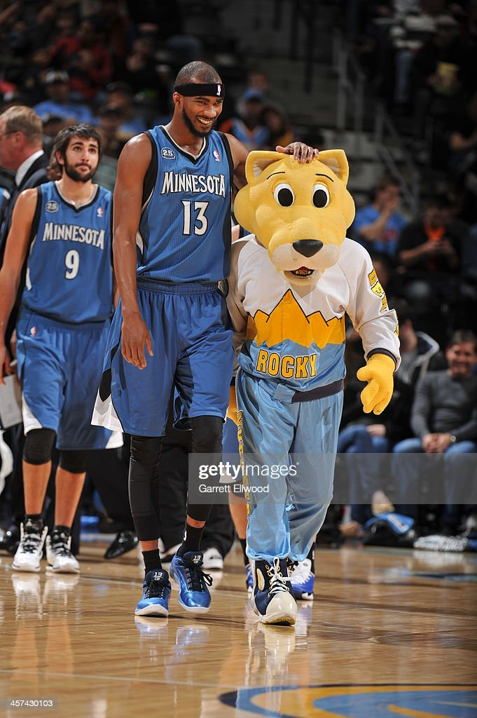 Corey Brewer #13 of the Minnesota Timberwolves and Rocky the Denver Nuggets mascot talk during the game on November 15, 2013 at the Pepsi Center in Denver, Colorado.