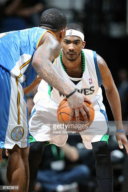 Corey Brewer of the Minnesota Timberwolves defends against JR Smith of the Denver Nuggets during the game on March 10 2010 at the Target Center in...