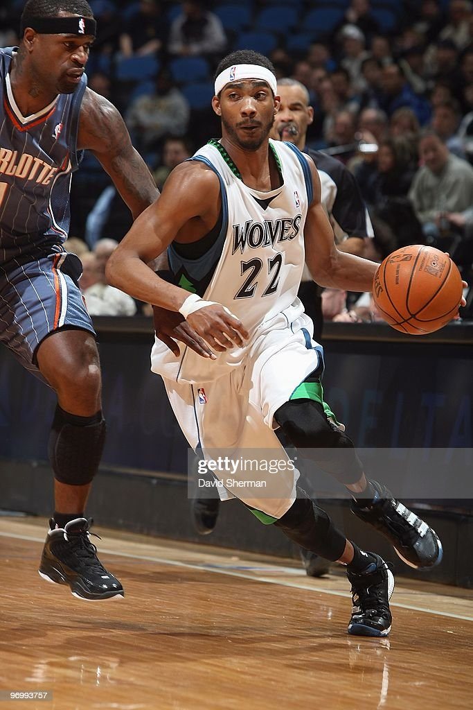 Corey Brewer of the Minnesota Timberwolves drives past Stephen Jackson of the Charlotte Bobcats during the game on February 10 2010 at the Target...