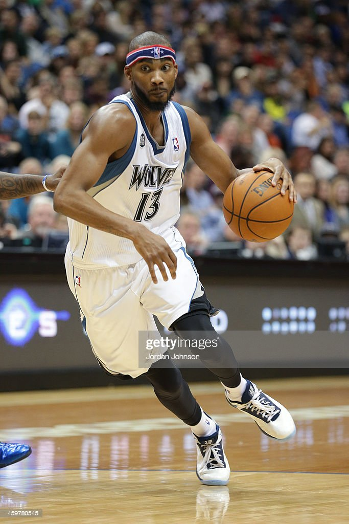 <a gi-track='captionPersonalityLinkClicked' href=/galleries/search?phrase=Corey+Brewer&family=editorial&specificpeople=234749 ng-click='$event.stopPropagation()'>Corey Brewer</a> #13 of the Minnesota Timberwolves drives to the basket against the Dallas Mavericks on November 8, 2013 at Target Center in Minneapolis, Minnesota.