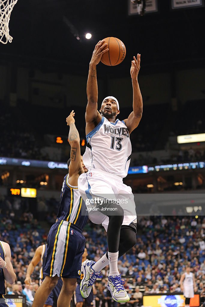 <a gi-track='captionPersonalityLinkClicked' href=/galleries/search?phrase=Corey+Brewer&family=editorial&specificpeople=234749 ng-click='$event.stopPropagation()'>Corey Brewer</a> #13 of the Minnesota Timberwolves drives to the basket against the Utah Jazz on April 16, 2014 at Target Center in Minneapolis, Minnesota.