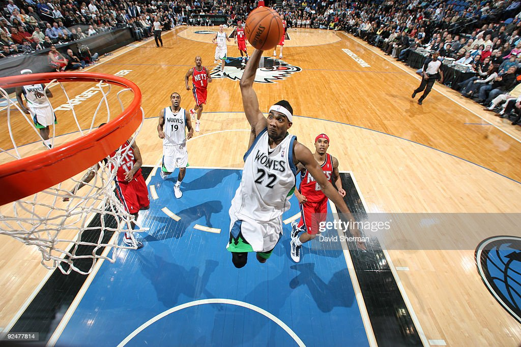 Corey Brewer of the Minnesota Timberwolves dunks against the New Jersey Nets during the season opening game on October 28 2009 at the Target Center...