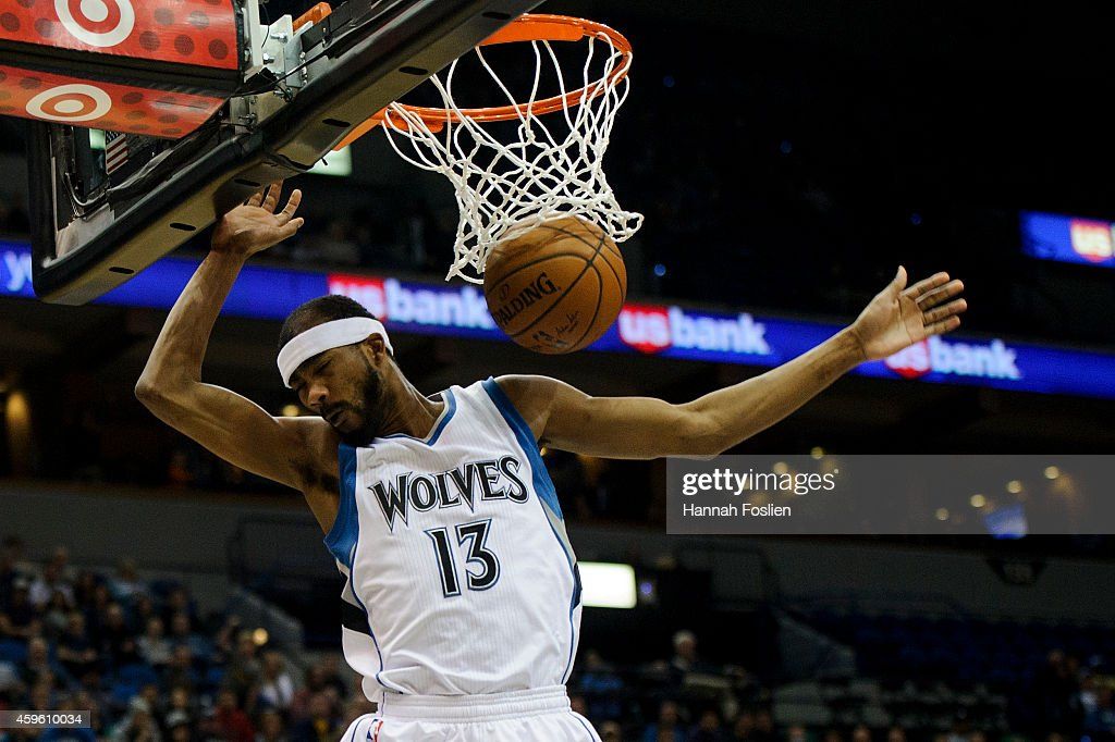 Corey Brewer of the Minnesota Timberwolves dunks the ball against the San Antonio Spurs during the game on November 21 2014 at Target Center in...