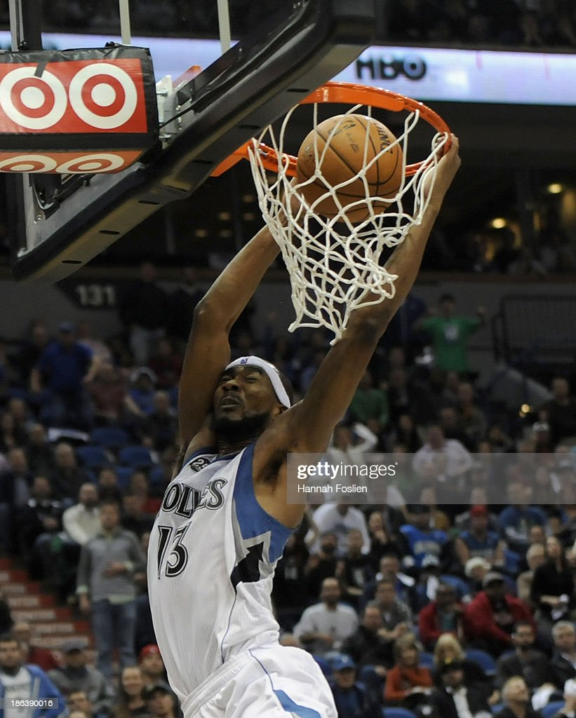 Corey Brewer #13 of the Minnesota Timberwolves dunks the ball during overtime of the season opening game against the Orlando Magic on October 30, 2013 at Target Center in Minneapolis, Minnesota. The Timberwolves defeated the Magic 120-115 in overtime.