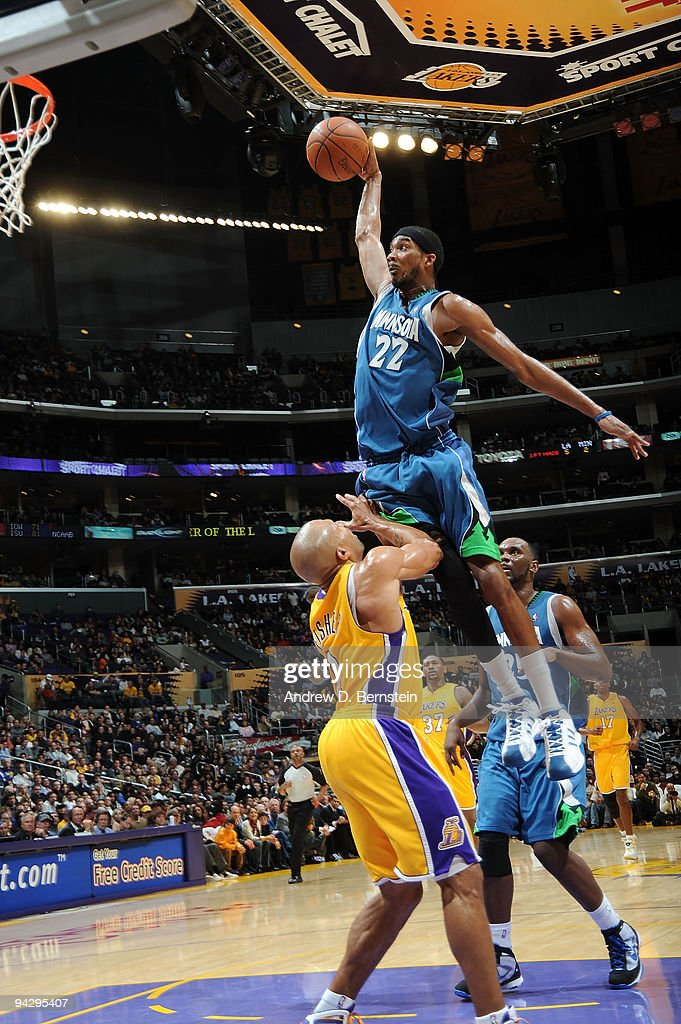 Corey Brewer of the Minnesota Timberwolves goes up for a dunk against Derek Fisher of the Los Angeles Lakers at Staples Center on December 11 2009 in...