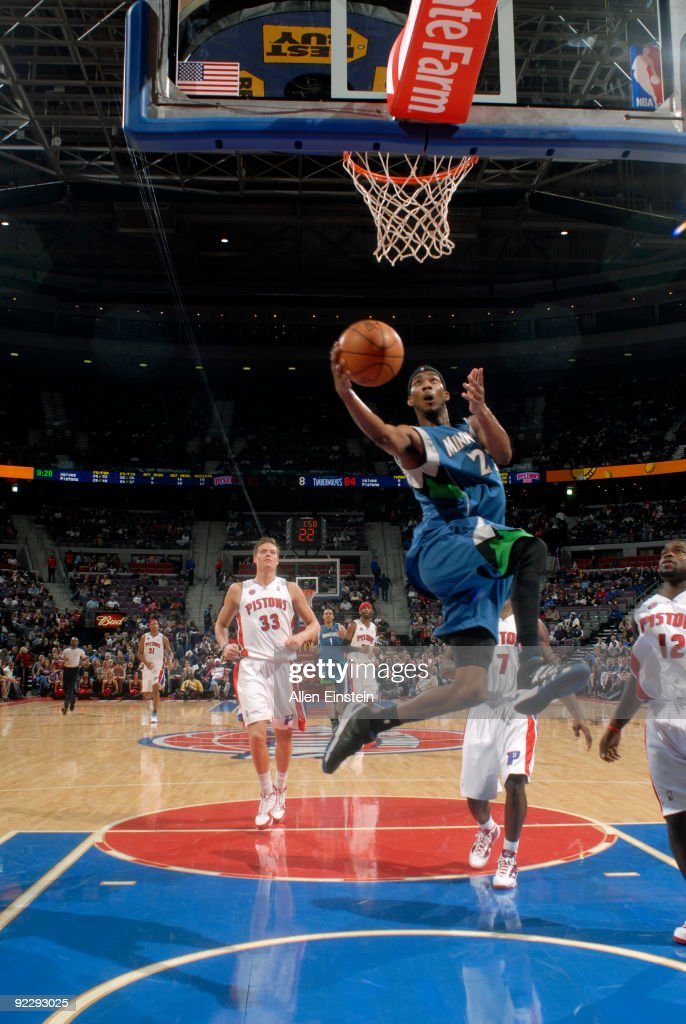 Corey Brewer of the Minnesota Timberwolves goes up for a shot attempt past Will Bynum of the Detroit Pistons in a preseason game at the Palace of...