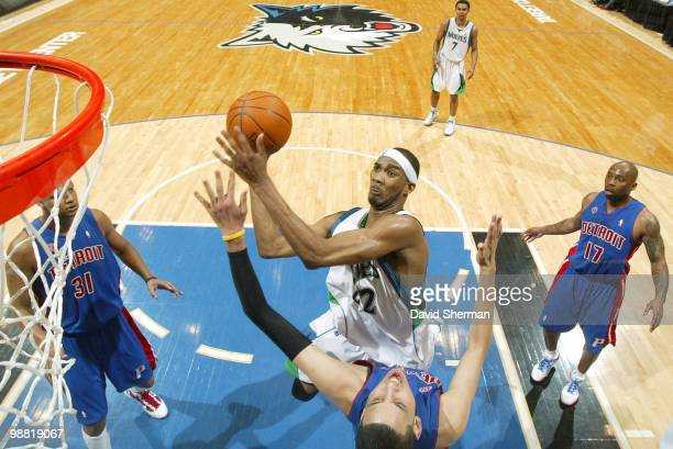 Corey Brewer of the Minnesota Timberwolves goes up for the jump shot in the key against Austin Daye of the Detroit Pistons during the game at Target...