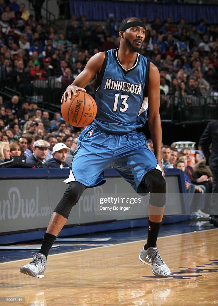 Corey Brewer of the Minnesota Timberwolves handles the ball against the Dallas Mavericks on November 15 2014 at the American Airlines Center in...