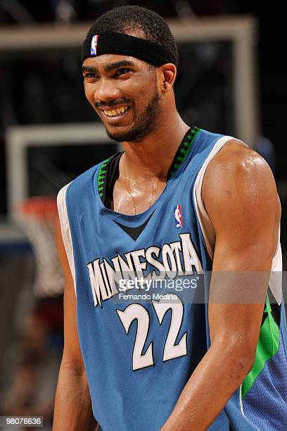 Corey Brewer of the Minnesota Timberwolves laughs with a teammate against the Orlando Magic during the game on March 26 2010 at Amway Arena in...