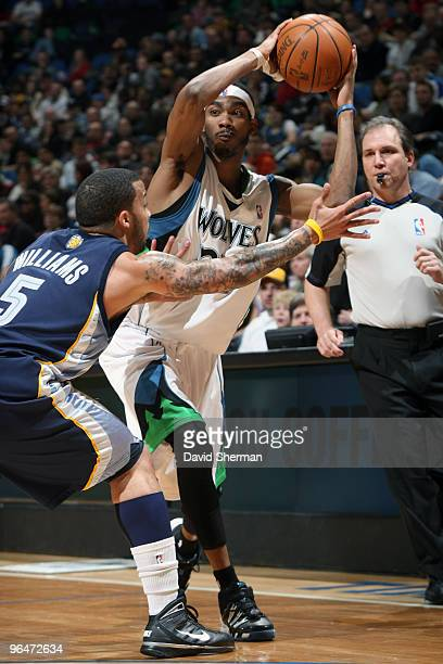 Corey Brewer of the Minnesota Timberwolves looks to pass against Marcus Williams of the Memphis Grizzlies during the game on February 6 2010 at the...