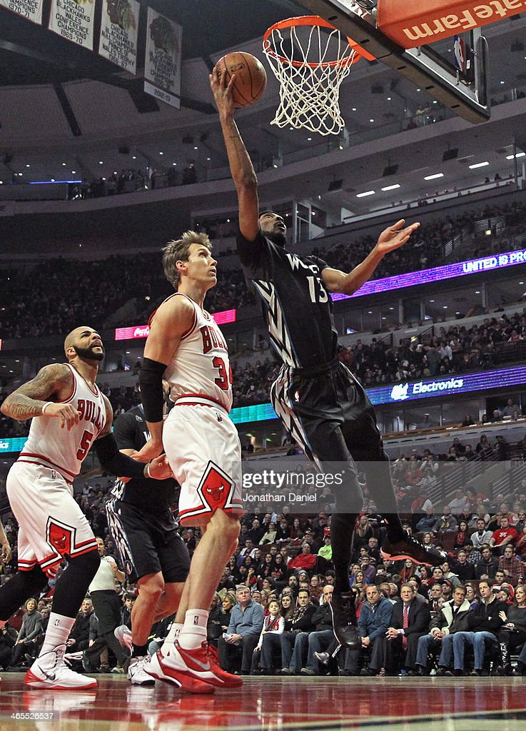 Corey Brewer #13 of the Minnesota Timberwolves puts in a shot over Mike Dunleavy #34 of the Chicago Bulls at the United Center on January 27, 2014 in Chicago, Illinois. The Timberwolves defeated the Bulls 95-86.