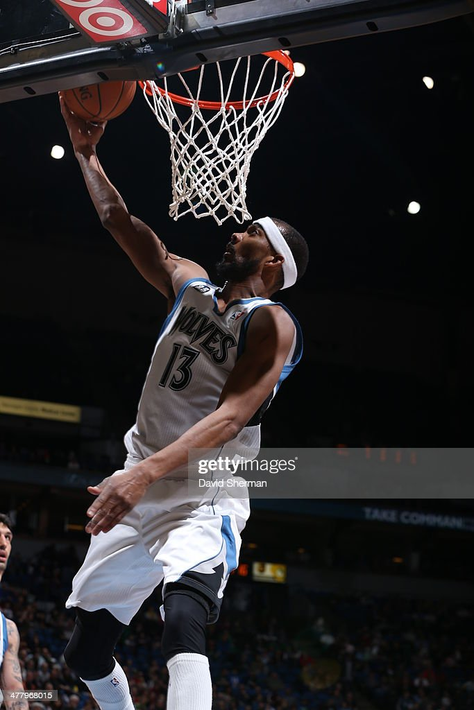 Corey Brewer #13 of the Minnesota Timberwolves shoots against the Milwaukee Bucks on March 11, 2014 at Target Center in Minneapolis, Minnesota.