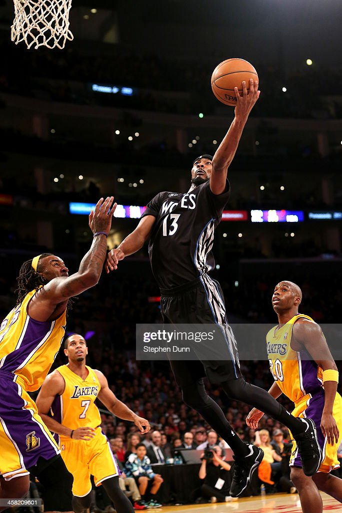 Corey Brewer of the Minnesota Timberwolves shoots over Jordan Hill of the Los Angeles Lakers at Staples Center on December 20 2013 in Los Angeles...