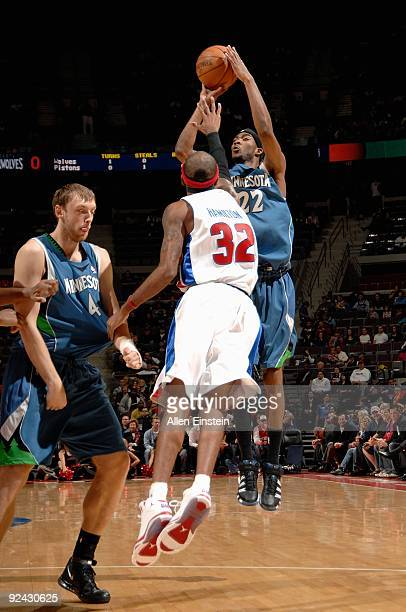 Corey Brewer of the Minnesota Timberwolves shoots over Richard Hamilton of the Detroit Pistons during the preseason game on October 22 2009 at The...