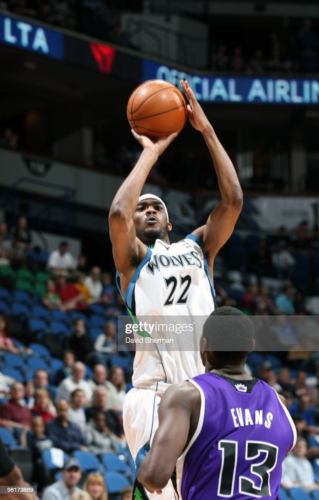 Corey Brewer of the Minnesota Timberwolves shoots over Tyreke Evans of the Sacramento Kings during the game on March 31 2010 at the Target Center in...