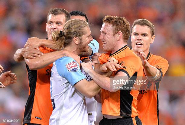Corey Brown of the Roar and Luke Brattan of Melbourne City face off during the round five ALeague match between the Brisbane Roar and Melbourne City...