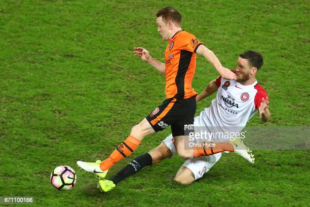 Corey Brown of the Roar and Robert Cornthwaite of the Wanderers compete for the ball during the ALeague Elimination Final match between the Brisbane...