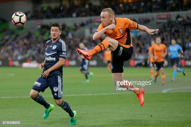 Corey Brown of the Roar clears the ball during the ALeague Semi Final match between Melbourne Victory and the Brisbane Roar at AAMI Park on April 30...