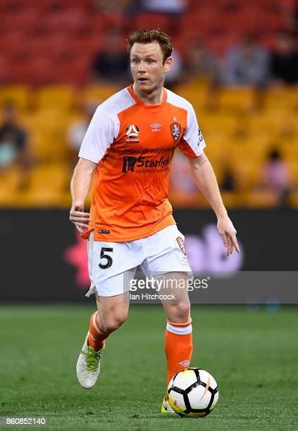 Corey Brown of the Roar dribbles the ball during the round two ALeague match between the Brisbane Roar and Adelaide United at Suncorp Stadium on...