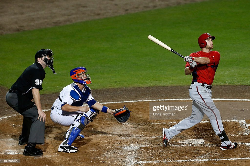 Corey Brown #10 of the Washington Nationals at bat as <a gi-track='captionPersonalityLinkClicked' href=/galleries/search?phrase=John+Buck&family=editorial&specificpeople=213730 ng-click='$event.stopPropagation()'>John Buck</a> #44 of the New York Mets looks on at Tradition Field on February 25, 2013 in Port St. Lucie, Florida.
