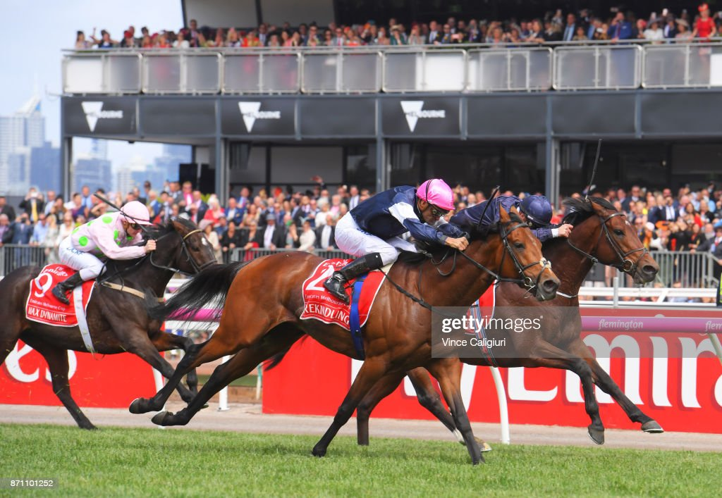 Corey Brown riding Rekindling defeats Ben Melham riding Johannes Vermeer and Zac Purton riding Max Dynamite in Race 7, Emirates Melbourne Cup , during Melbourne Cup Day at Flemington Racecourse on November 7, 2017 in Melbourne, Australia.