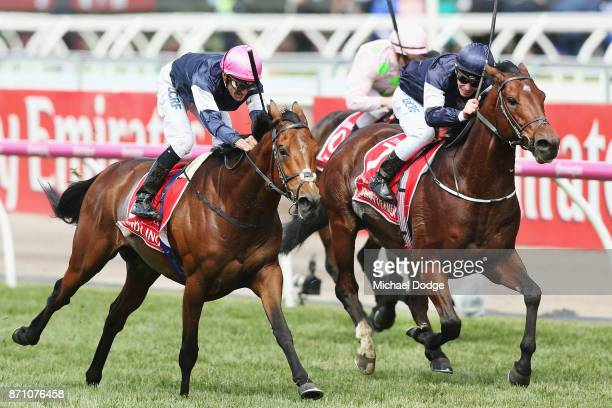 Corey Brown riding Rekindling wins race 7 the Emirates Melbourne Cup ahead of Ben Melham riding Johannes Vermeer during Melbourne Cup Day at...