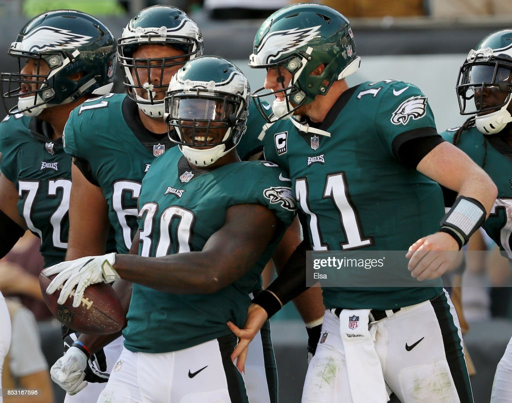 ... NFL football Corey Clement 30 of the Philadelphia Eagles is  congratulated by teammate Carson Wentz 11 ... 1b16109c4