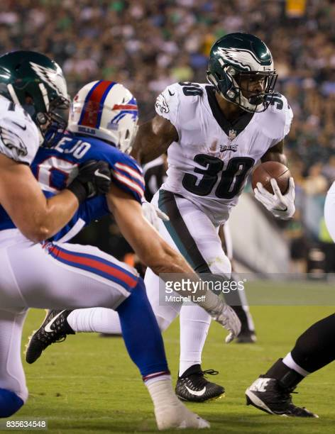 Corey Clement of the Philadelphia Eagles runs the ball against Tanner Vallejo of the Buffalo Bills in the preseason game at Lincoln Financial Field...