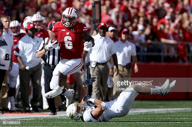 Corey Clement of the Wisconsin Badgers avoids a tackle attempt by Zach Guiser of the Akron Zips in the second quarter at Camp Randall Stadium on...