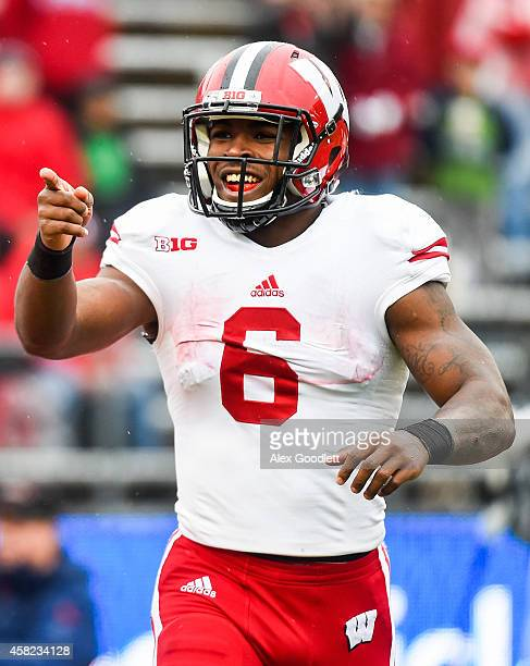 Corey Clement of the Wisconsin Badgers celebrates a touchdown in the fourth quarter during a game against the Rutgers Scarlet Knights at High Point...