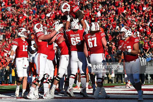 Corey Clement of the Wisconsin Badgers celebrates a touchdown with teammates during the first half of a game against the Illinois Fighting Illini at...