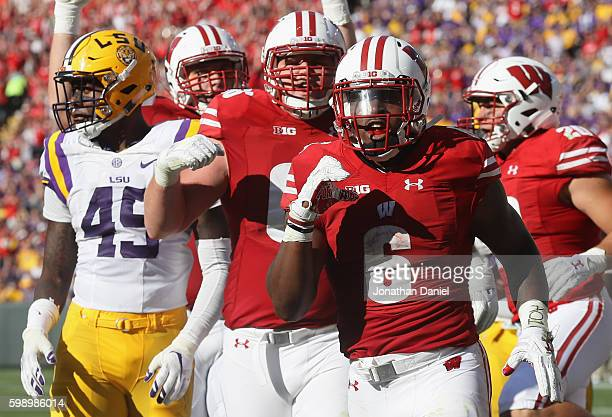 Corey Clement of the Wisconsin Badgers celebrates scoring a touchdown during the third quarter against the LSU Tigers at Lambeau Field on September 3...