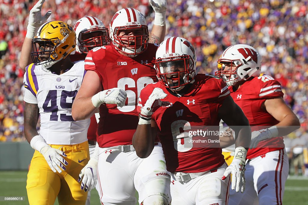 Corey Clement #6 of the Wisconsin Badgers celebrates scoring a touchdown during the third quarter against the LSU Tigers at Lambeau Field on September 3, 2016 in Green Bay, Wisconsin.