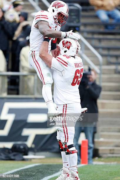Corey Clement of the Wisconsin Badgers is lifted up by Ryan Ramczyk after rushing for a sixyard touchdown against the Purdue Boilermakers in the...